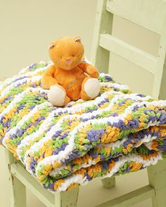 Baby Blanket - Ripple Baby Blanket (knit)- Three easy-to-follow rows and one bulky yarn make this squishy blanket an easy and quick gift that looks great! Shown in Bernat Baby Blanket.