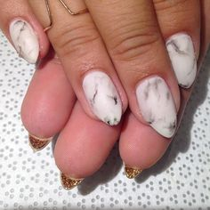 matte marble nails with gold glitter backing.