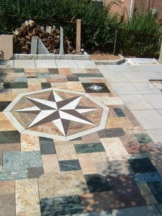 Recycled granite countertops and PA Flagstone with granite cobble curb.    A DIY project!