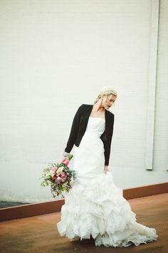 Classic Wedding Dress with a Black Leather Jacket | Follow us  www.facebook.com/StLouisPerfectWeddingGuide