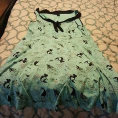 Torrid Little Mermaid Dress This is a sailor style dress. It os roomy and has pockets. Only worn once! Torrid Dresses Midi