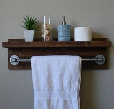 Handmade bathroom shelf with towel bar. A perfect addition to any home, apartment, or country cottage.  Made from solid wood. It has been sanded down,