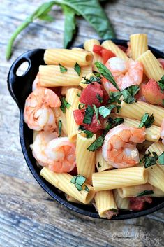 1 pound of rigatoni pasta, 1 tablespoon of olive oil, 1.5 pounds of large shrimp (peeled and deveined), ½ teaspoon of red pepper flakes, ¼ teaspoon of salt, 1 small onion (chopped), 1 garlic clove (minced), 1 15 ounce can of no salt added diced tomatoes, ¼ cup of white wine, ½ cup of fresh basil (chopped) and 2 tablespoons of half  half.