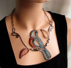 Bluebird on a branch necklace. Handcrafted branch, bird, leaves, and clasp from recycled copper. Has Czech glass, Swarovski and Czech crystal, and hematite.