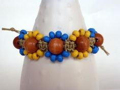 Row of Flowers Micro Macrame bracelet in Blue and Yellow. $12,00, via Etsy.