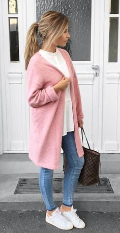 #fall #outfits  women's pink coat, faded blue fitted jeans and white low top sneakers