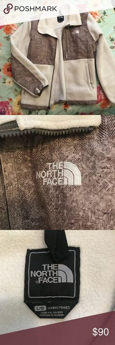 North face zip up jacket Women's North Face zip up jacket in bone white (slightly off white) with brown detailing. Elastic band around bottom to adjust fit around waist. 3 front pockets. Women's size large. In great condition, only worn a few times.   Please feel free to ask questions, bundle for deals or make an offer :) North Face Jackets & Coats