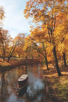 A peaceful autumn trip down the canal in Riga.