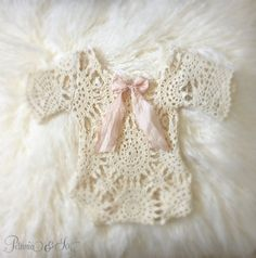 Newborn ivory lace romper. Open ivory crochet lace romper with scalloped sleeve…