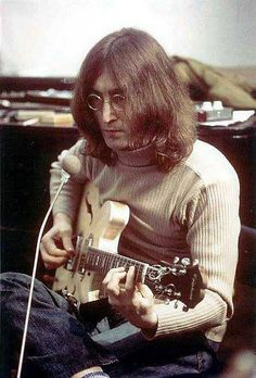 John Lennon (with his Epiphone Casino. Never saw this one before!)