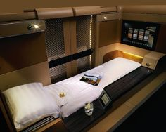 These 9 Luxurious First Class Airline Seats Will Make You Wish Your Flight Was Even Longer Etihad sports a luxurious flatbed seat in each of its suites which, at the touch of a button, shifts into a 8 bed First Class Airline, Flying First Class, First Class Flights, Private Plane, Private Jets, Trains, Business Class, Air Travel, Shopping