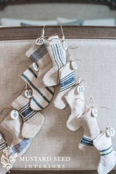Craft a mashup of two Christmas decorations by hanging up this cute advent stocking garland in your home.