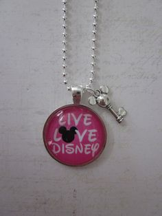 Live Love Disney Pink/Black/White Glass Pendant Necklace With Silver Mickey Key Charm. $14.99, via Etsy.