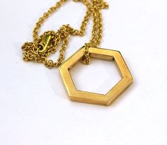 Some simple geometry from my shop. Bronze and brass hexagon pendant TaraMacJewellery on Etsy