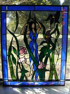 Mother Nature Stained Glass Panel. $925.00, via Etsy.