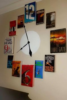 DIY Wall Clock made of Book Covers that reference the according number on the clock. Takes up a good amount of space on the wall but might be good in the den!