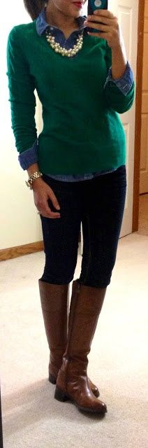 Green sweater, black pants, brown boots, and pearls
