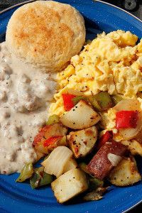 The Pioneer Woman - Biscuits with sausage gravy, scrambled eggs, and breakfast potatoes with peppers and onions