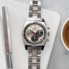 Live now this instantly recognizable tri-colour dialled Zenith El Primero A3817 from the 1971 is a design classic and the quintessential vintage sports watch; purposeful and smart. Famous for their distinctive high-beat chronograph timepieces  technically advanced wristwatches are very much in Zeniths DNA. And - carrying the Calibre 3019 PHC - this piece belongs to the prestigious line of the first-ever automatic chronographs. There has been a continuing and passionate debate which…