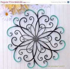 For those with the need for a splash of color......  This metal floral wall design has been refinished in an ombre style with gray center black