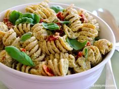 Creamy Pesto Pasta Salad made with greek yogurt and whole wheat pasta.  Less than 200 calories per serving. #salad
