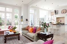 Open plan living room and kitchen with extension in contemporary London family home  UK