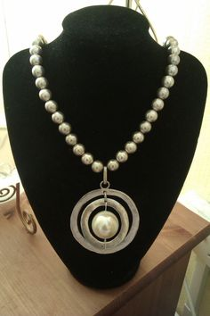 Chunky metallic circle pendant and silver bead necklace by Euphena, £25.00