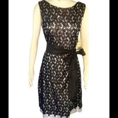 Plus- Black and White Party Dress Prom Dress this up with fancy shoes or keep it simple and elegant with pearls.  This dress is STUNNING!  Black floral patterned lace over shiny white and a sweet black tie.  Great for a semi-formal or to a wedding.  Dress completely lined inside.  Nylon she'll, polyester lining.  Hits above the knee.  Retails for $89 Sangria Dresses Midi