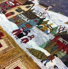 Photo-2  from First stitches Canon City Quilt Shop & Sewing Store.  A Jeanne Benjamin rug pattern hooked by Molly Crotty