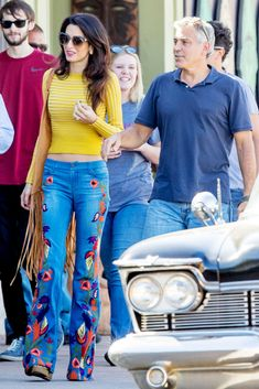 In Alice & Olivia embroidered jeans while with George Clooney on the set of Suburbicon in Los Angeles.