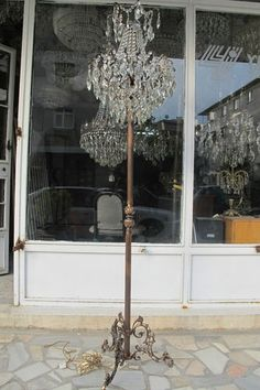 vintage chandelier turned into floor lamp- love this idea!!!!