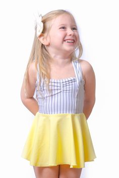 eloise in hello sunshine #reyswimwear #reyswimwearlittles #swimdress #toddlerswimdress #modestswimsuit