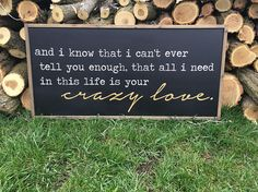all i need in this life is your crazy love sign.  lyrics from the song die a happy man by thomas rhett.  sign features a black background with white and gold fonts and custom driftwood colored stain frame.*  *this listing can be customized with your choice of paint colors. if not discussed prior to check out, colors show above will be shipped.  sign shown measures approximately 25 x 13 inches.  sign comes with sawtooth hanger attached.  sign has been sealed with protective matte coating…