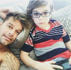 Ricky Martin and one of his twin sons. Adorable boricuas.