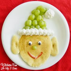 Santa's Elf Pancake Breakfast ~  You Need: >Pancake Recipe or Mix  >Green Grapes >Whipped Cream Spray >1 Mini Marshmallow >1 Strawberry >2 Chocolate Chips.  How To @: http://kitchenfunwithmy3sons.blogspot.com/2013/11/santas-elf-pancakes-for-fun-christmas.html