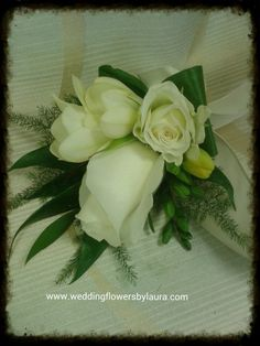 white roses, fressia and spray rose wrist corsage www.weddingflowersbylaura.com