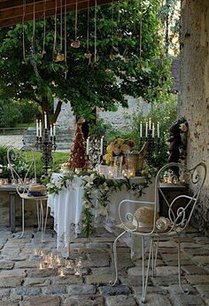 An intimate garden party need not be expensive. This one is using a lot of candles to set the mood. I wouldn't put those candles on the ground! Be safe.