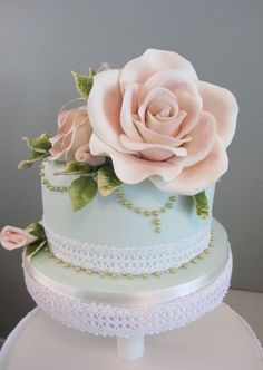 Cake is a 6 with a 4 gumpaste Rose and gold pearls