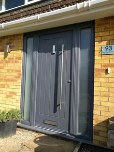 Very popular and modern grey Rockdoor fitted with stainless bar handle. House Design, House Front, Contemporary Front Doors, Entrance Doors, Beautiful Homes, Grey Front Doors, Grey Houses, Front Door Design, Door Bar