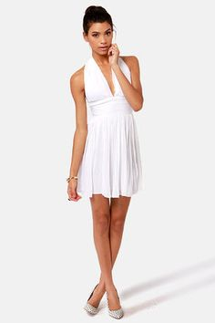 cute! Check it out from Lulus.com! Calling all bombshells! The BB Dakota Graciela White Halter Dress is just what you need to revamp your va-va-voom! Channel Marilyn herself with a come-hither pleated chiffon skirt that flows freely in the breeze. Pleats on the sexy halter neckline and banded waist team up with a no-slip strip to maximize your vixen appeal while keeping things classy. Hidden back zipper. Lined. Model is wearing a size 0. 100��0Polyester. Hand Wash Cold. Imported.