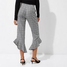 Woven fabric Gingham print Asymmetric frill hems Side slip pockets High waisted Straight, cropped leg Zip fly hook and bar fastening Our model wears a UK 8 and is 175cm/5'9'' tall