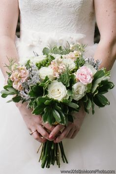 Kristin Moore Photography captured this bouquet. We love all the texture and foliage going on here, if you zoom in, you can see fresh herbs and all sorts of other goodies.