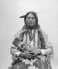 """Apiatan - Kiowa. In 1890, the Kiowa heard rumors of a """"Man from the North"""" that had seen Jesus, had seen all the dead people, the buffalo, and the country where all the dead people lived with Jesus. He had seen rivers, good grass and plenty of food. It was the place the white people called the Happy Hunting Ground. Apiatan left in search of this man. He spent 2 yrs searching til he found the Paiute man, Wovoka, whom he interviewed and determined it was a hoax. He returned home much disappointed."""