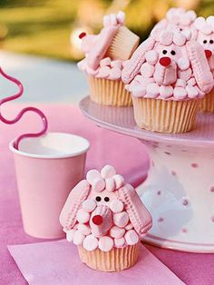 Poodle Cupcakes - How fun for a birthday party! Pink frosting and marshmallows make the dog's cute little faces for this party dessert.