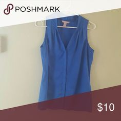 Cobalt blue sleeveless Banana Republic top Cobalt blue sleeveless Banana Republic top with gathers at neck and a placket down the front. Sizze small. 100% polyester. Can wear by itself or under sweater or jacket Banana Republic Tops