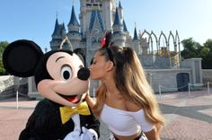 Ariana Grande Celebrates  her 21st Birthday At Walt Disney World and gives Mickey Mouse a kiss in front of in front of Cinderella's Castle in the Magic Kingdom June 24, 2014 in Lake Buena Vista, Florida