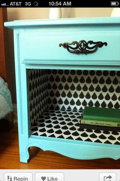 Take out the bottom drawer and wallpaper the inside.