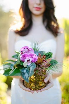 Colorful orchid centerpiece | Joielala Photography | see more on: http://burnettsboards.com/2014/05/colorful-tropical-wedding-ideas/