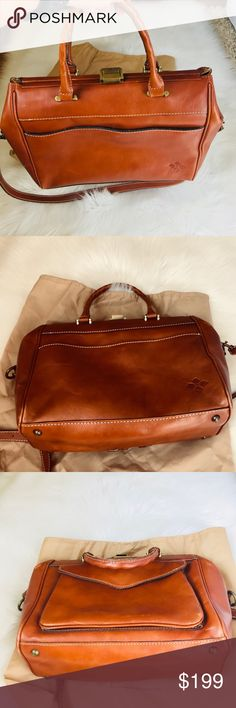 Patricia Nash Italian Leather Bag in Cognac This is a beautiful and well crafted bag from Patricia Nash. The luxurious Italian  leather is just stunning. Fully lined with Patricia Nash signature soft velvet material. It has wall zipper pocket and slip pockets. The exterior has that envelope style pocket for your phone storage and the front pocket has the magnetic closure. It's a head turner bag and super chic. It comes with strap for Crossbody use. The leather has minimal scuff due normal…
