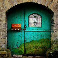 Turquoise door with painting ~ Germany